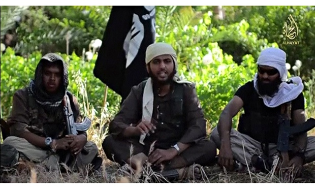 An Islamist fighter, identified as Abu Muthanna al-Yemeni from Britain, speaks in the Isis video